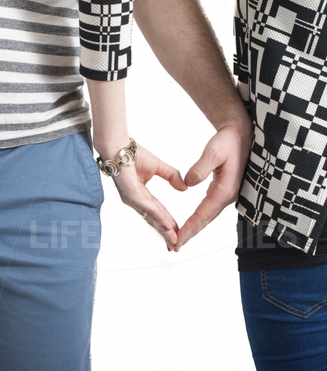 Couple hands touching fingers in the shape of heart