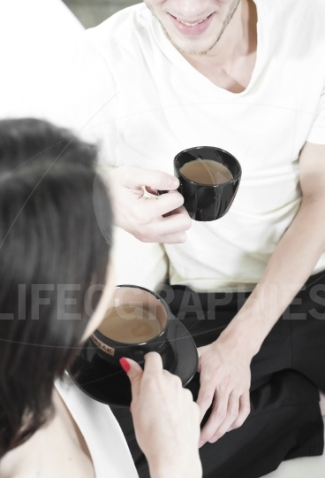 Couple sharing a cup of coffee