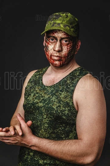 Creative and Funny Military Style Camouflage on Tankman Face