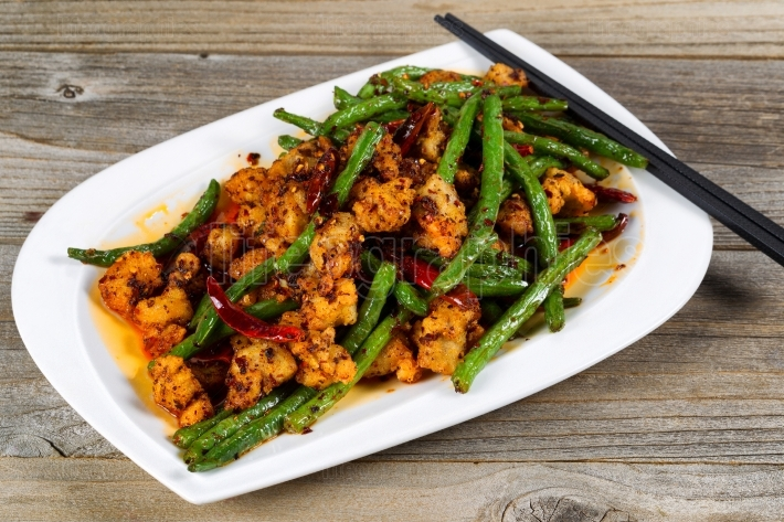 Crispy chicken and green bean dish ready to eat