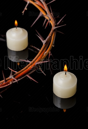 Crown of thorns of Jesus Christ at candles lights