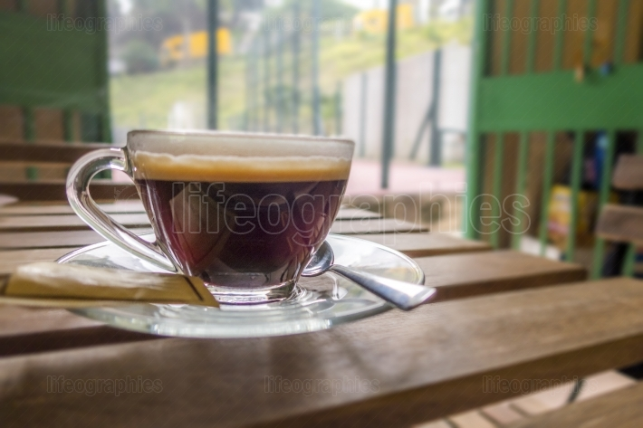 Cup of Black coffee on a wooden table