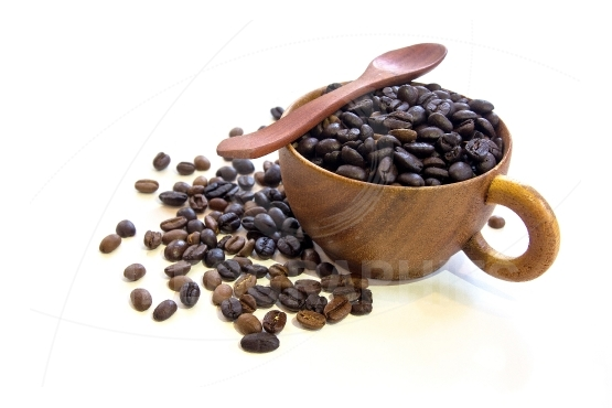 Cup with coffee beans isolated on  background.