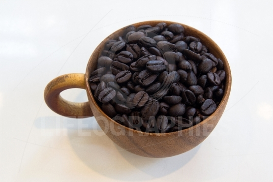 Cup with coffee beans isolated on  table white background