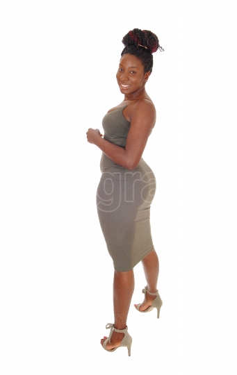 Curvy young African woman standing in profile