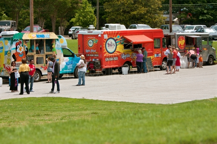 Customers Buy Meals From Food Trucks At Spring Festival