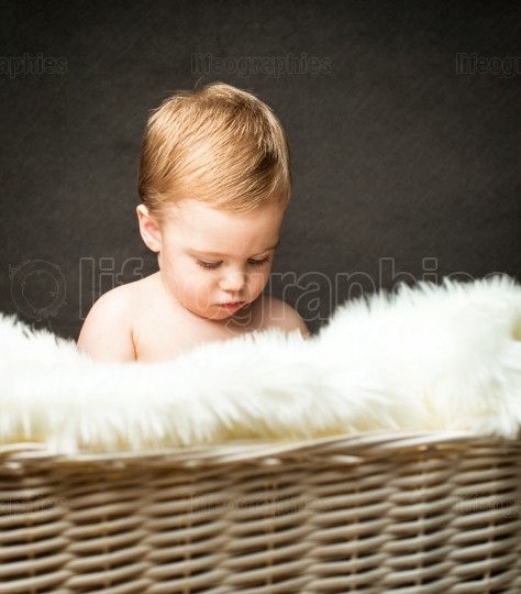 Cute blonde little boy isolated