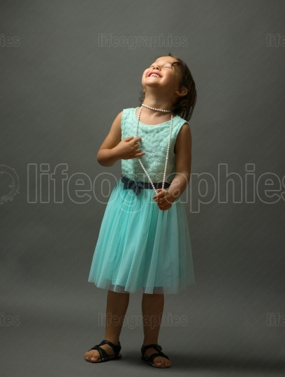 Cute little girl in beautiful dress in studio