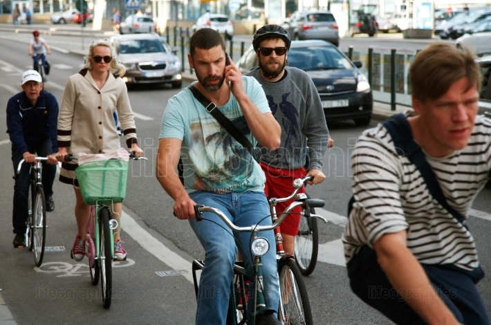 Cyclist talking on a mobile telephone