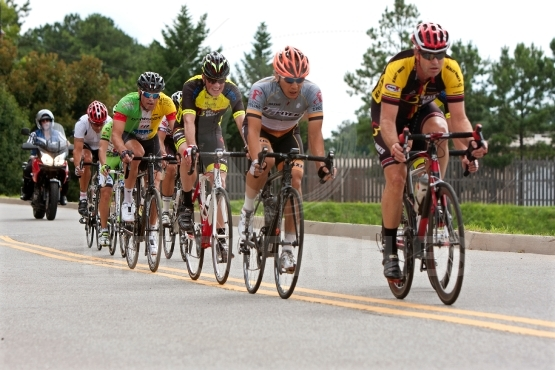Cyclists sprint down straightaway in duluth criterium event