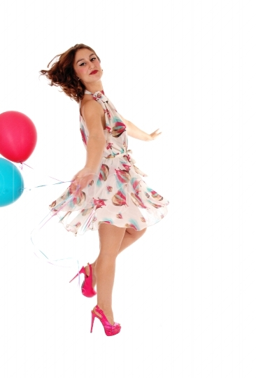 Dancing woman with balloon's.