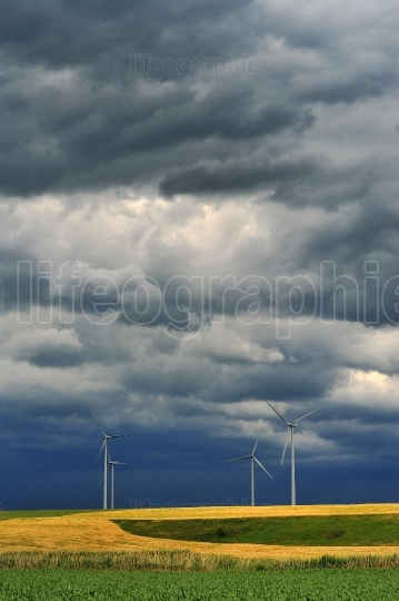 Dark rain clouds on wind power installations.