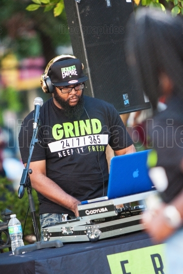 Deejay uses electronics to play music at hip hop festival