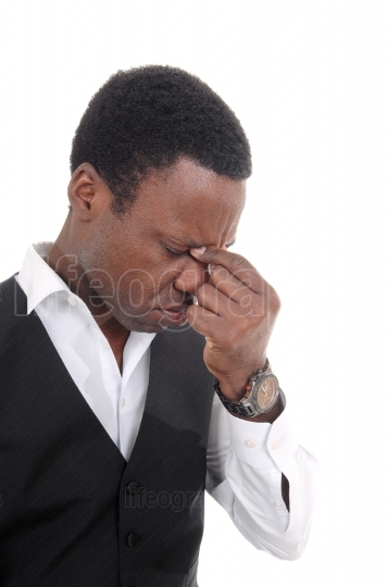 Depressed African man with hand on face