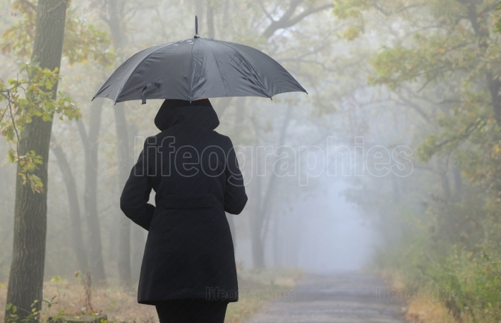 Depressed woman with red umbrella