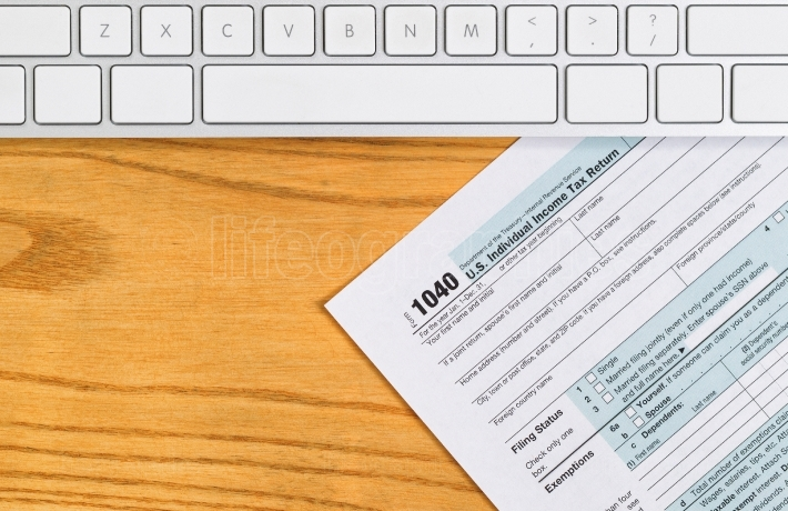 Desktop with basic IRS tax form