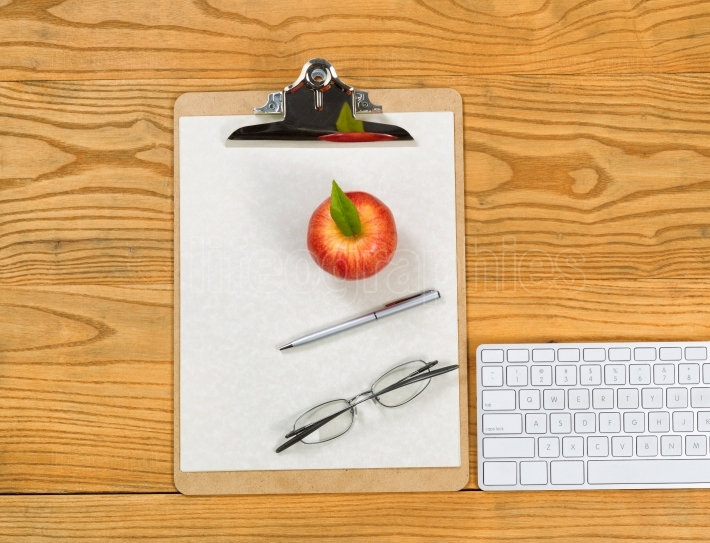 Desktop with clipboard and office supplies