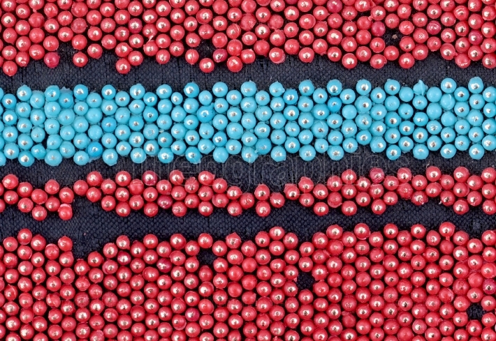 Detail of old bracelets made of plastic beads