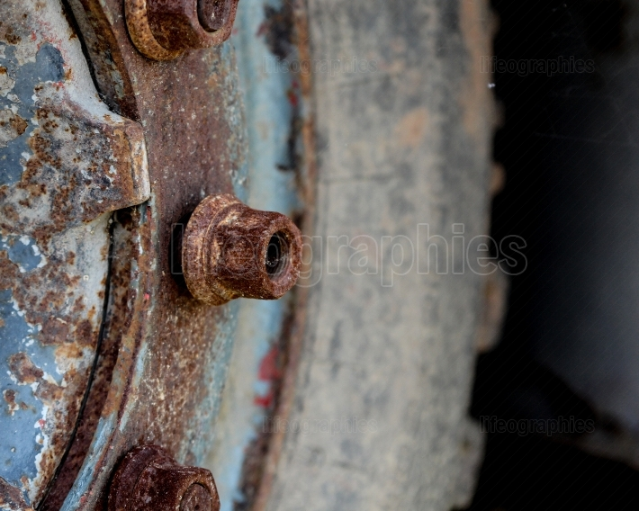 Details close upof and old rusty truck wheel