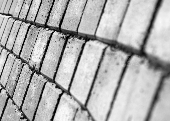 Diagonal black and white pavement texture background