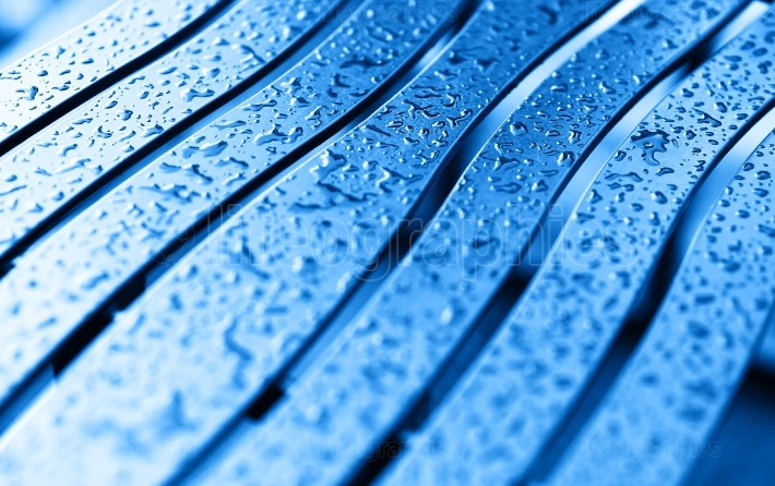 Diagonal blue bench with rain drops background