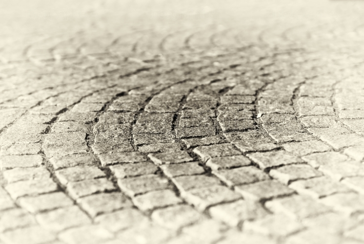 Diagonal medieval Norway pavement in sepia background
