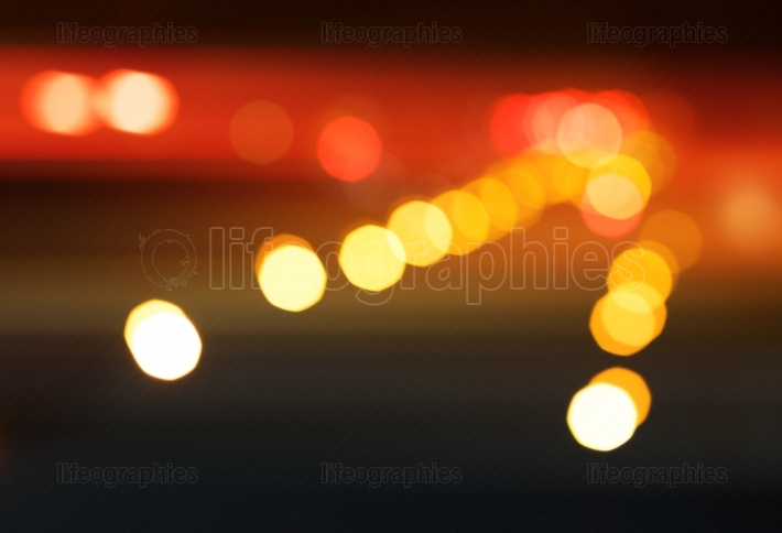 Diagonal night city road illumination bokeh background