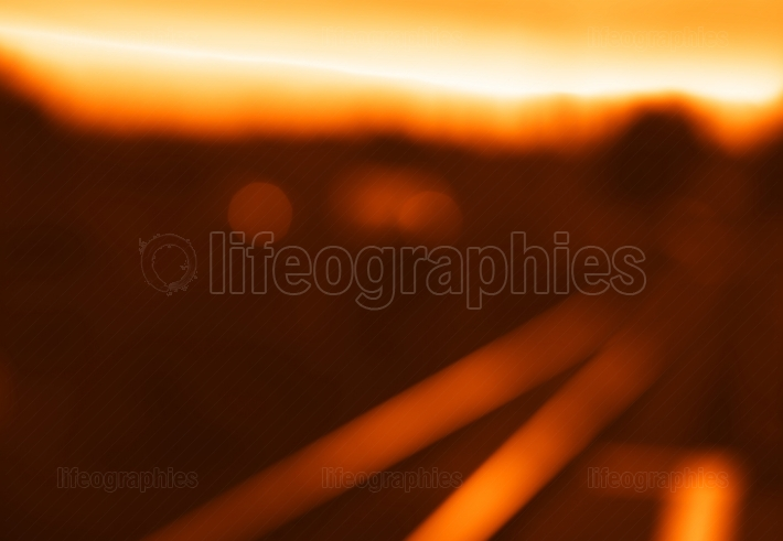Diagonal sunset railroad bokeh background
