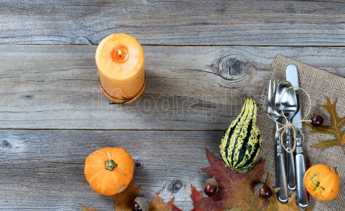 Dinnerware setting for autumn Thanksgiving holiday on rustic woo