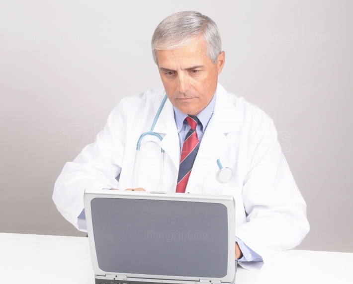Doctor at Desk with Computer