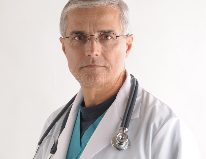 Doctor in Scrubs and Labcoat with Stethoscope closeup