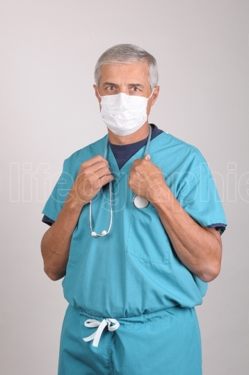 Doctor in Scrubs and Mask with Stethoscope