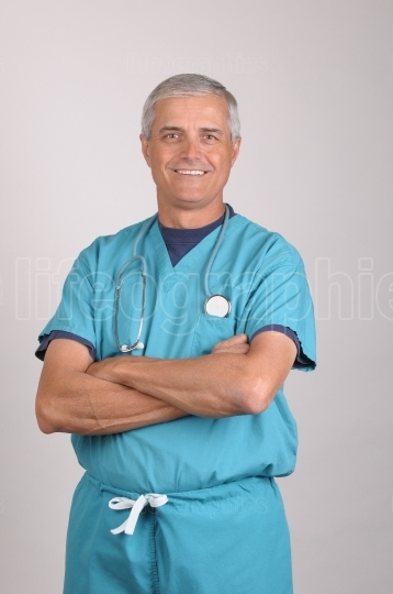 Doctor in Scrubs with  Arms Folded