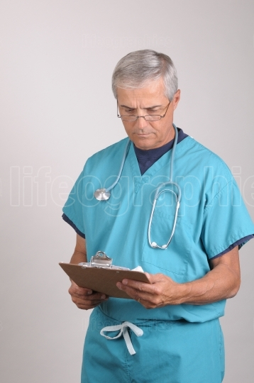 Doctor in Scrubs with clipboard