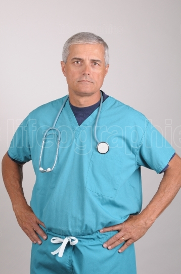 Doctor in Scrubs with Hands on Hips