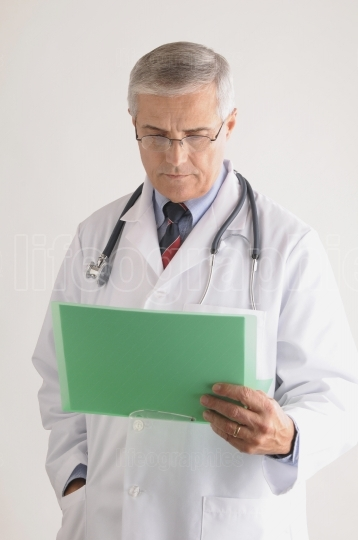 Doctor Looking at Patients Chart