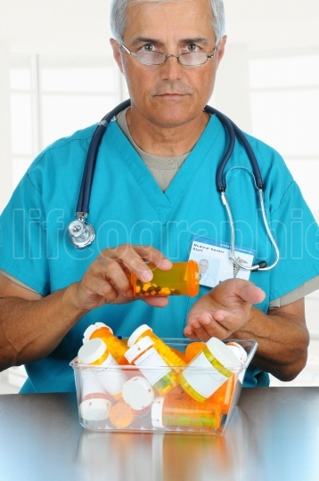 Doctor pouring pills into his hand