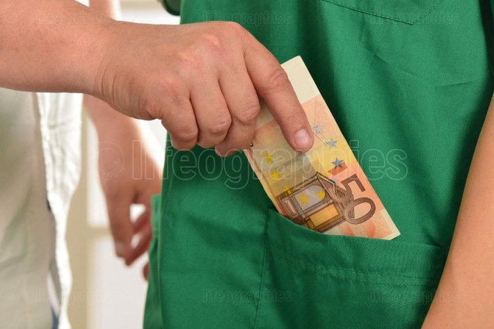 Doctor receiving euro banknotes as a bribe
