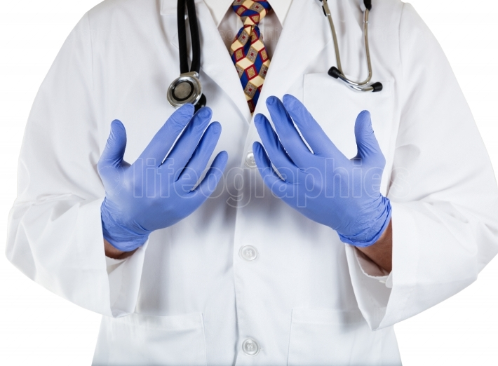 Doctor with blue latex gloves on hands