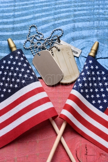 Dog Tags and Flags on Patriotic Table