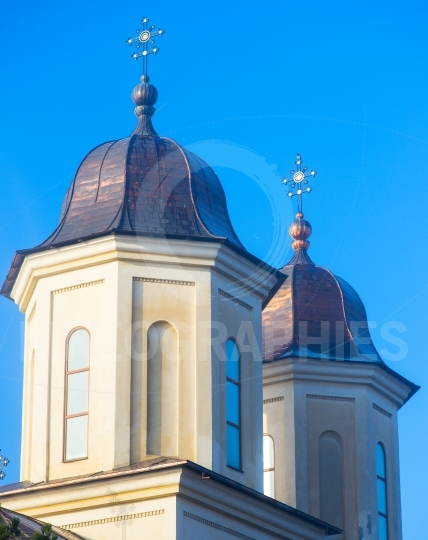 Domes of the Orthodox church with crosses on blue sky background
