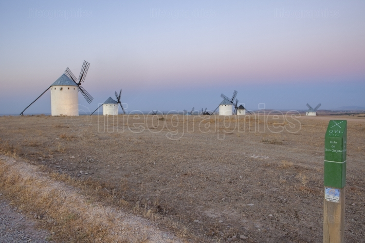 Don Quixote route post with windmills at rising, La Mancha, Spai