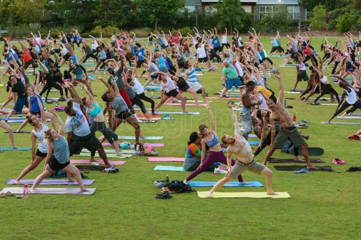 Dozens Of People Stretch At Free Outdoor Atlanta Yoga Class