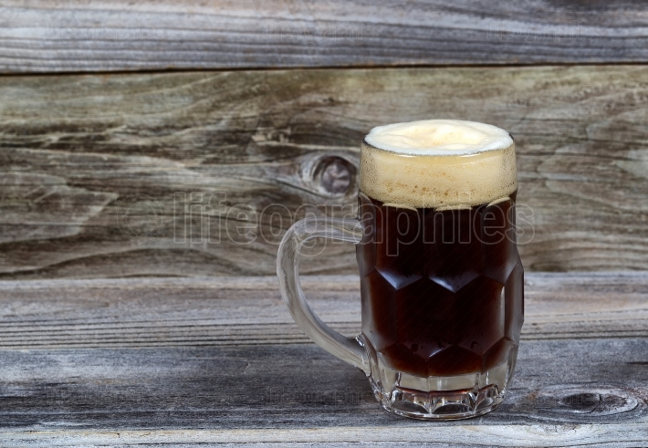 Draft Stout Beer in Glass Stein on Rustic Wood