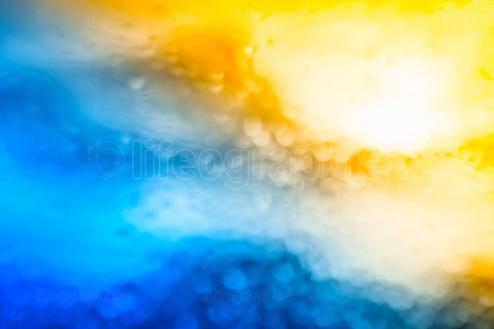 Dramatic sun in sky bokeh background