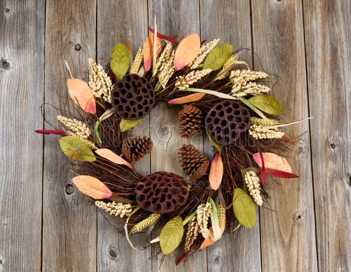 Dried nature wreath on rustic wooden boards