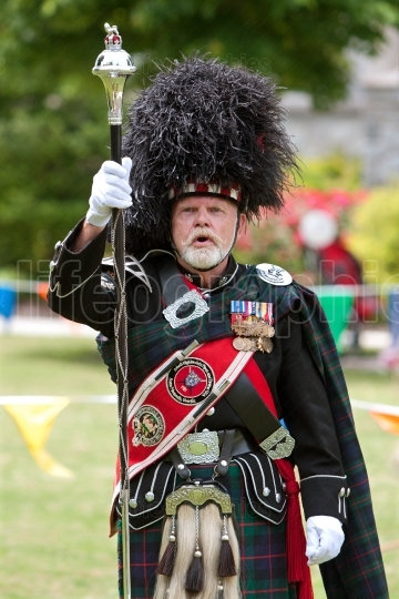 Drum Major Leads Pipe And Drums Unit At Spring Festival