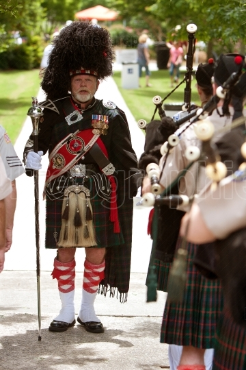 Drum Major Prepares To Lead Bagpipes Group At Festival
