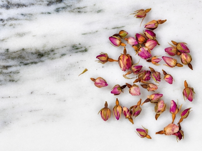 Dry flowers on natural white marble stone