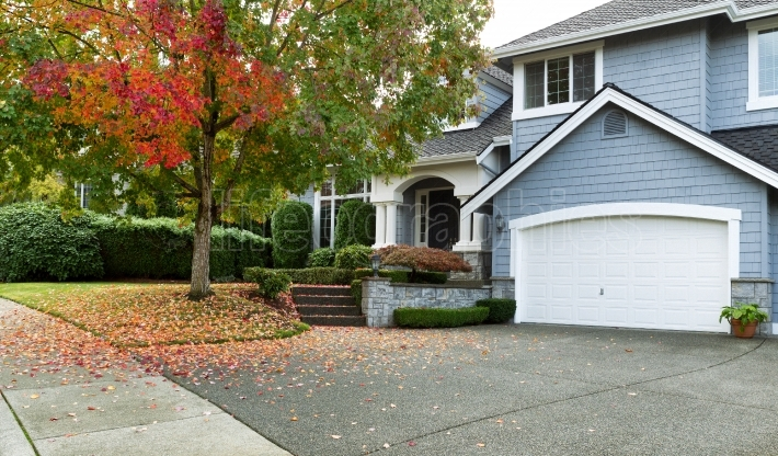 Early autumn with modern residential single family home